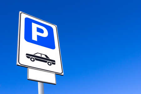 Car parking sign against clear sky background. Blank label and sky for text. Stockfoto