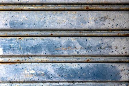 empty warehouse: Closeup old roller shutter textureabstract background.