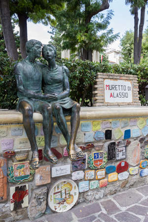 Alassio (SV), ITALY - August 22, 2017: Muretto di Alassio, the famous Little Wall in Alassio with the bronze statue of the lovers.