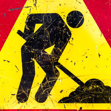 worn out: One sign of attention, road works. The sign is old, worn out. Stock Photo