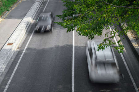 Motion blur of cars in aerial view over the road. (Speed limits - Infractions - Speed Cameras) Stock Photo