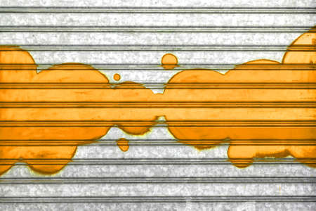 Orange bubbles painted with spray paint on a roller shutter. Stock Photo