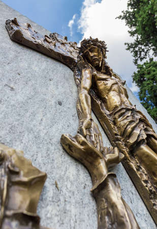 Jesus frees himself from the cross and shakes his hand to a faithful. Shallow depth of field. Stock Photo