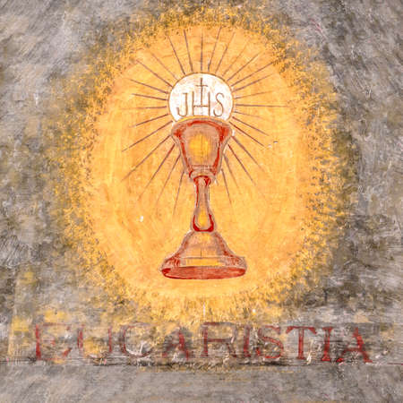 Fresco depicting the sacred chalice of Jesus. Eucaristia in Italian means: Eucharist, Holy Communion, Communion.