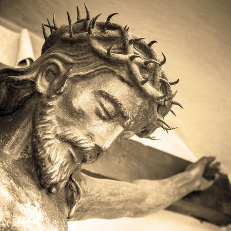 The suffering of Jesus Christ. Details of the bronze statue. Sepia tone. Stock Photo