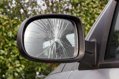 Closeup of damaged rearview mirror