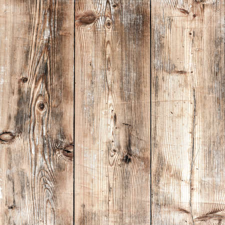 Close-up of the three old wooden boards vertically arranged
