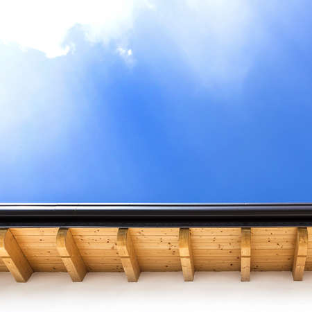 Roof with wood rafters and planks. Italian house.