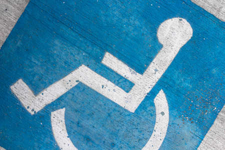 Disability symbol painted on the floor Archivio Fotografico