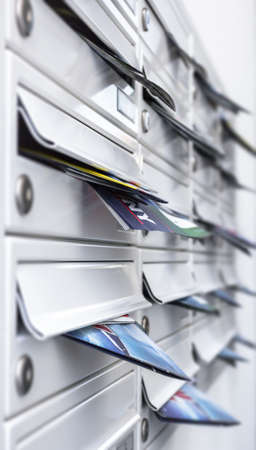 Mailboxes filled of leaflets. Concept of spam and junk mail.