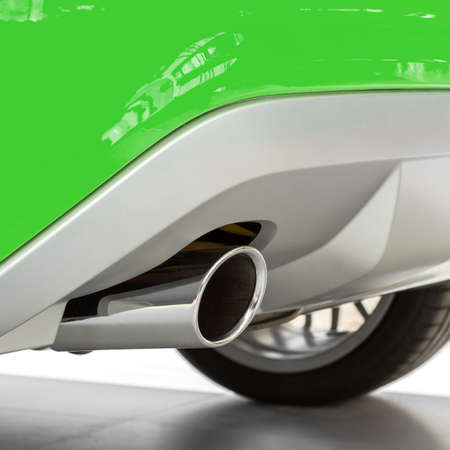 Eco car with new exhaust of a sports car. Ecology concept, low emission, low environmental impact. Stock Photo