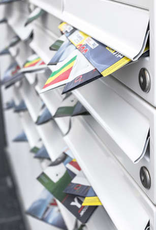 Modern mailboxes filled of leaflets. Business and advertising concepts. Shallow depth of field.