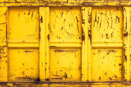 Closeup of a yellow rubble container. It can be used as background.