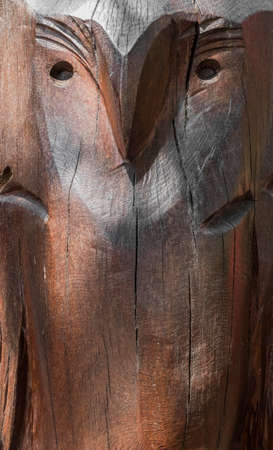 Carved wooden surface with the image of an owl. Ideal for concepts and backgrounds.