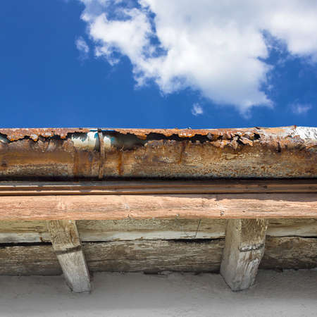 Broken gutter on the roof of a house