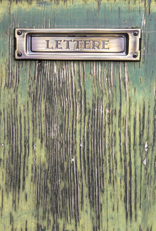 Old Italian mailslot with message