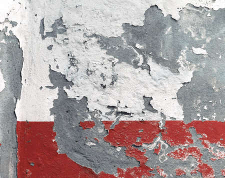Background of peeling old red plaster on wall