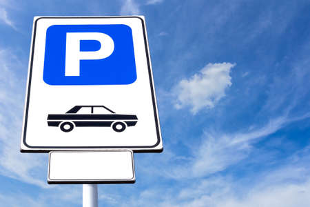 Parking sign with blue sky background on sunny day