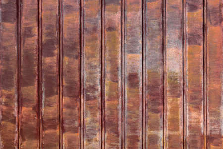 Close up of rusty shutters of a garage. Ideal for concept and backgrounds. Space for text.