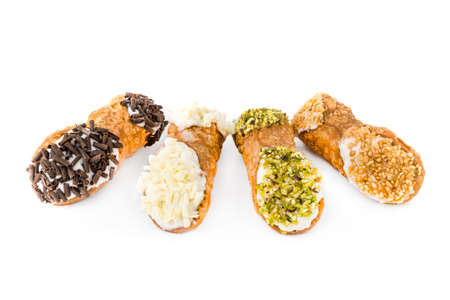 Traditional homemade Sicilian sweet. Cannoli, of different tastes stuffed with cream cheese.