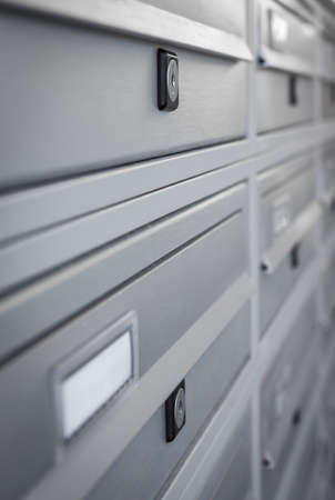 Modern Gray Mailboxes. They can be used for background and concepts. Shallow depth of field.