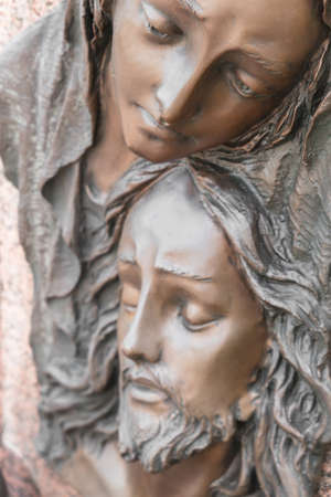 Bas-relief in bronze representing The Pity of Michelangelo. Faces of Holy Mary mother and Jesus Christ after the Crucifixion. Archivio Fotografico