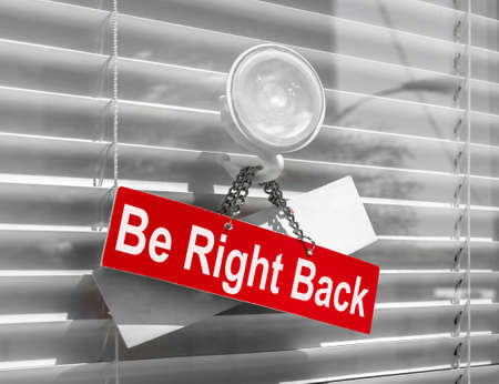 "Sign saying ""Be right back"" on a glass door with a white, closed venetian blind. It can be used for business concepts or backgrounds."