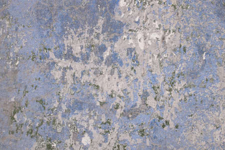 Concrete wall covered with an old azure paint, and parts of moss. It can be used as backgrounds and concepts.
