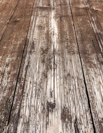 Close - up of an old wooden floor with rustic planks
