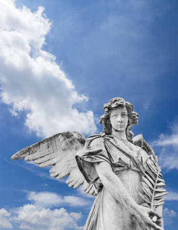 Statue of an angel with olive branches with sky and clouds in the background