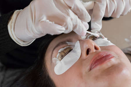 Cosmetic procedure of dyeing and lamination of eyelashes. Extension, perm, lamination of eyelashes. Eyelash care.