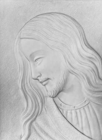 White stone Bas-relief of Christ smiling. Ideal for concepts and backgrounds.