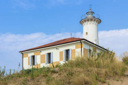 Bibione  Italy - August 24 ,2018: Lighthouse on the Adriatic riviera, against a blue sky with white clouds. Redakční