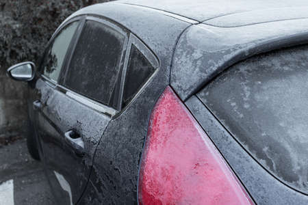 Frozen in the ice black car. Hoarfrost. Icy Accumulation. Ideal for concepts.