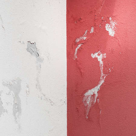Peeling painted wall, texture, grunge background, cracked paint with red wall.