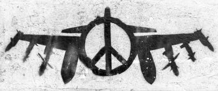 Peace symbol with bomber on grungy wall. Ideal for your creative artwork.