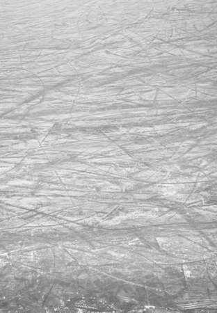 Scratches of skates on the ice of skating-rink. Ideal for concepts and backgrounds.
