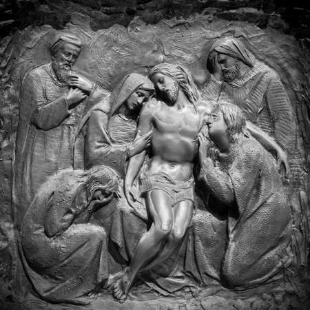 Bronze wall engraving scene depicting the Lamentation of Christ