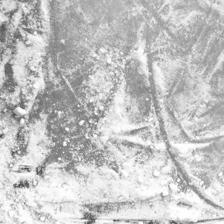 Ice rink floor, detail of a textured background ice. Sports and seasons.