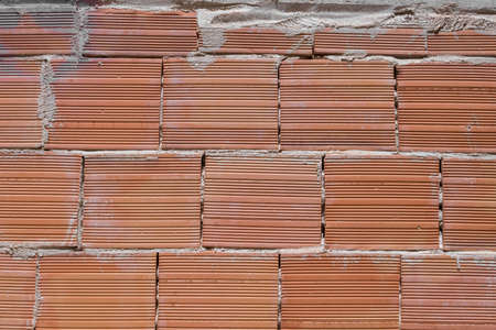 Building brick put in the wall, representing strong european way to build the houses.