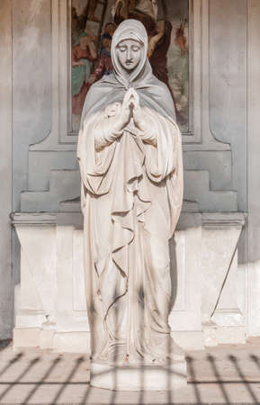 Statue of Mary with clasped hands. Ideal for Christmas and Easter concepts and other. Stok Fotoğraf
