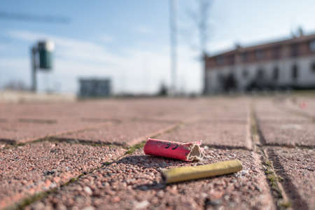 Old firecrackers exploded on the ground. Selected focus. Reklamní fotografie