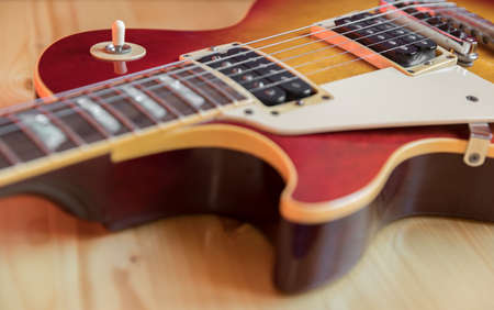 Detail of a electric guitar. Vintage style. Selective focus. Stock Photo - 131779686