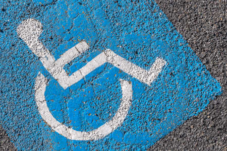 Close - up of disabled parking sign painted on tarmac. Ideal for concepts and backgrounds. Reklamní fotografie