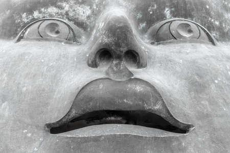 Modern sculpture of a man's face. Close-up.