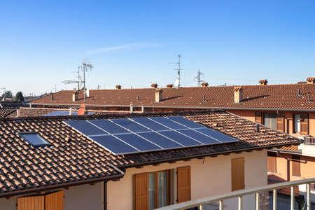 Solar panels on suburban Italian home. Photovoltaic power plant. Regenerative energy system electricity generation. 스톡 콘텐츠