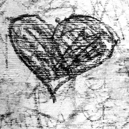 Black heart drawn on grungy background. Ideal for concepts of love and Valentines Day. 版權商用圖片