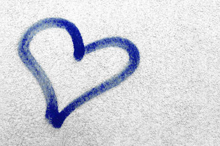 Concept or conceptual painted blue abstract heart shape love symbol, dirty wall background, metaphor to urban and romantic valentine, grungy style. 版權商用圖片