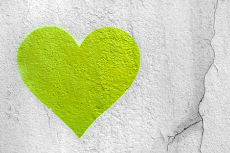 Lime love heart hand drawn on grungy wall. Textured background trendy street style.