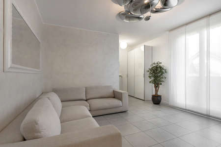 Italian interior design. Stylish living room in white color with sofa. 版權商用圖片
